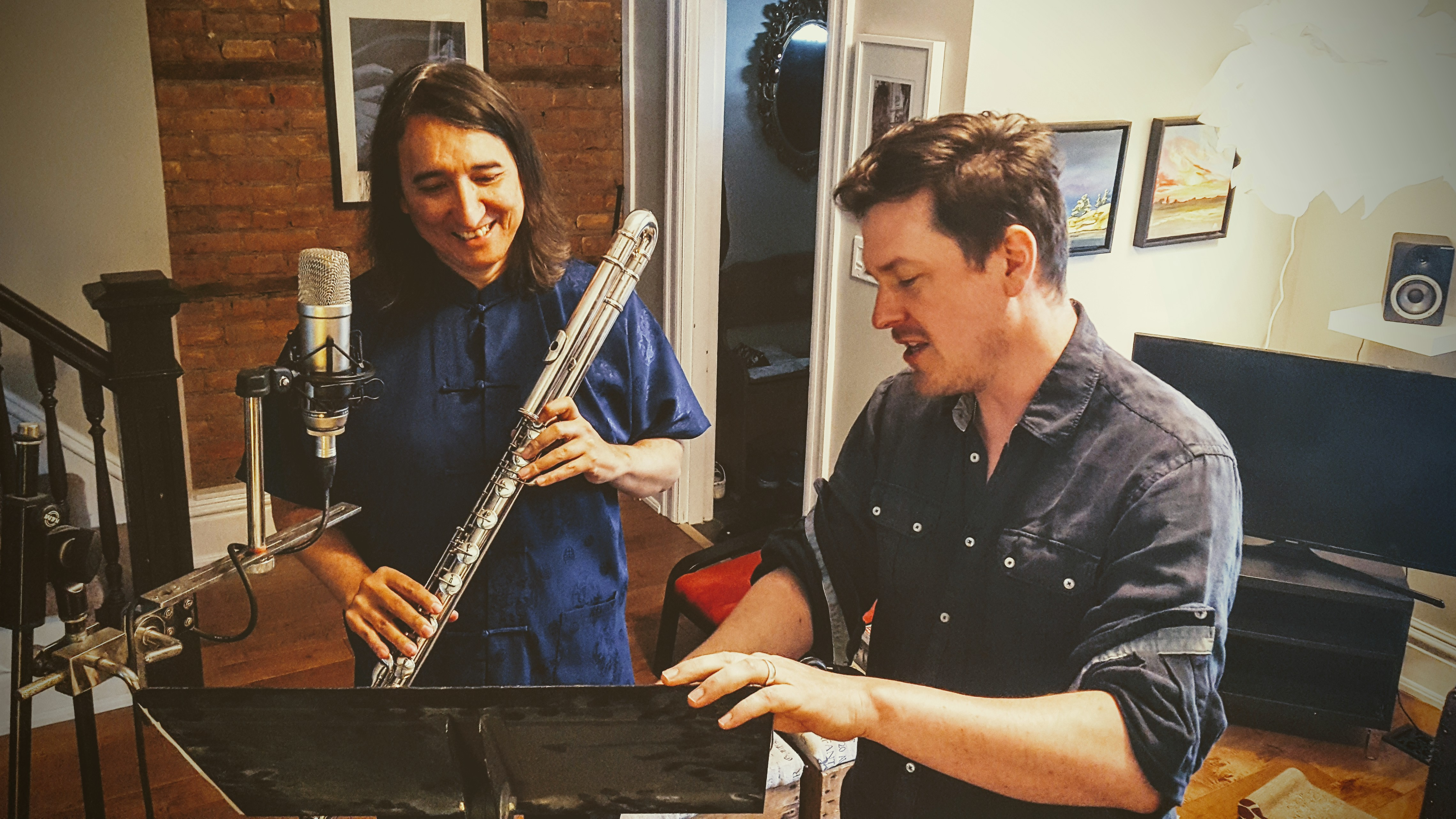 Adrian goes over parts with flautist Ron Korb
